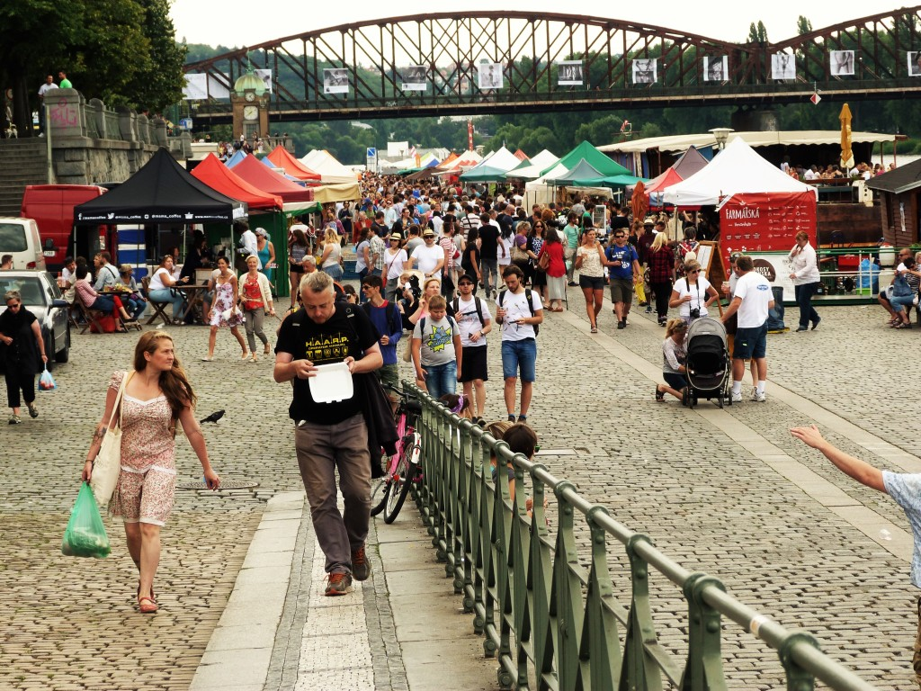 Look for the only railroad bridge crossing the river, and you'll know you've found the market at Náplavka.
