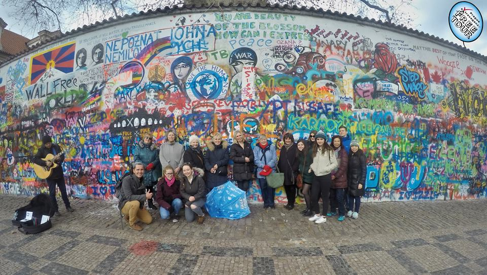 At the Lennon Wall with Extravaganza Free Tour.