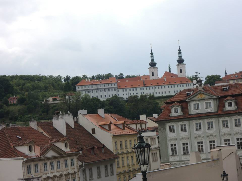 If you're standing anywhere in the center looking towards Prague Castle, just to the left of the castle, on the edge of Petřín Hill, you'll see the Strahov Monastery (pictured in the photo looming above the Malostrana district).
