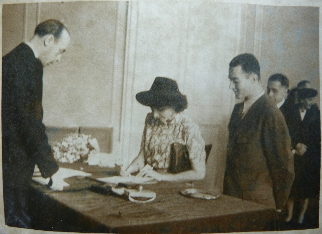 Robert Rada and Květa Hniličková signing the marriage register in Prague in 1945. Photo courtesy of Mélanie Rada.